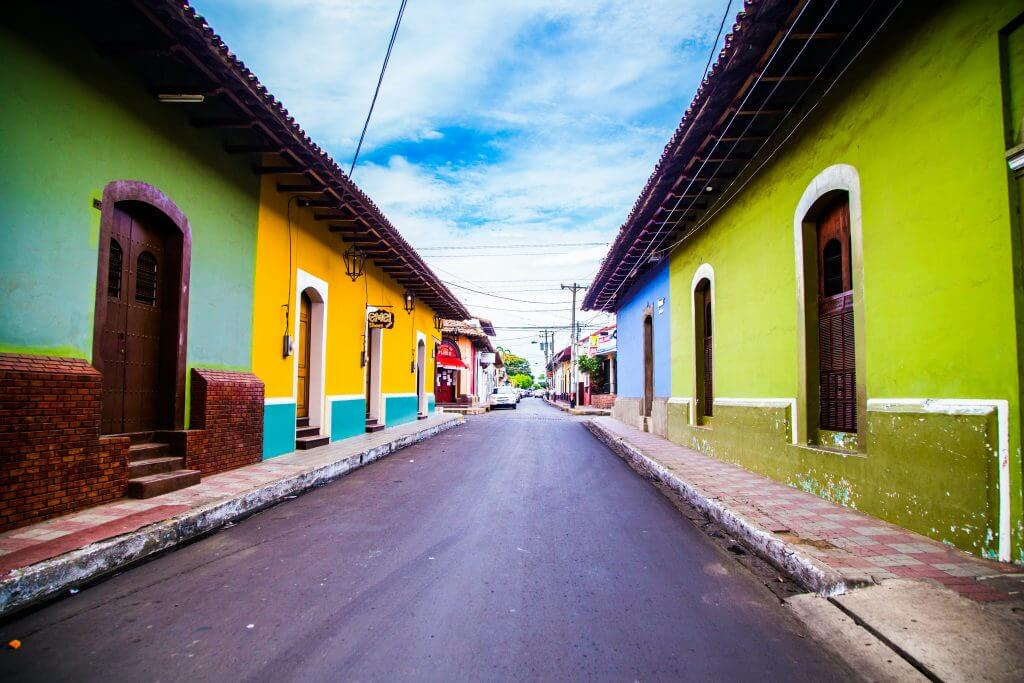 street in nicaragua lined with colorful houses